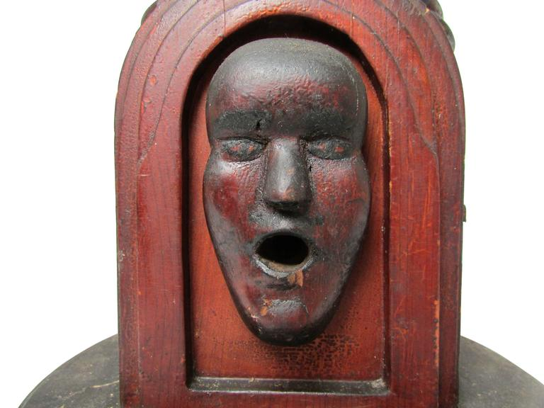This is a late 19th century one of a kind Folk Art cigarette (or joint) dispenser. Turning the small crank on the side of the dispenser allows for a single cigarette to drop into place. Then by pushing in the mechanism on the back of the dispenser,