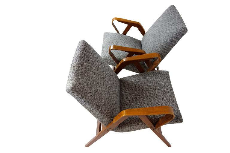 This is a beautiful pair of bentwood Tatra Nabytok lounge chairs in their original upholstery from the Czech Republic, circa 1950.