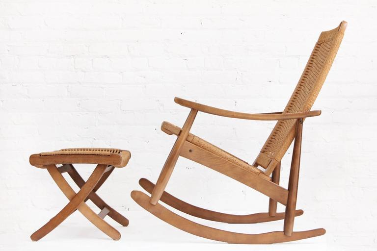 Woven rope Mid-Century Modern rocking chair and ottoman in the style of Hans Wegner. Made in Yugoslavia in the 1960s it is rare to find a matching ottoman.