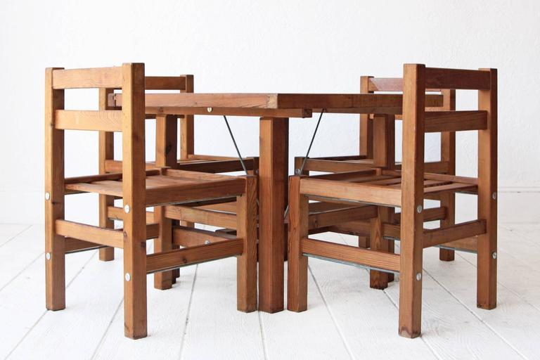 Solid redwood patio set by Elsa Stackelberg for Fri Form, Sweden. Diminutive dining table with hole for umbrella and four chairs. Custom cushions can be made upon request for an additional price. Measures: Table: 31.5