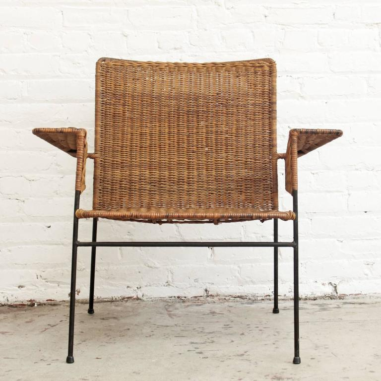 Indoor / outdoor chair in wrought iron and woven wicker by designers Hendrik van Keppel and Taylor Green. Made by Van Keppel-Green, circa 1950s. Iconic design.