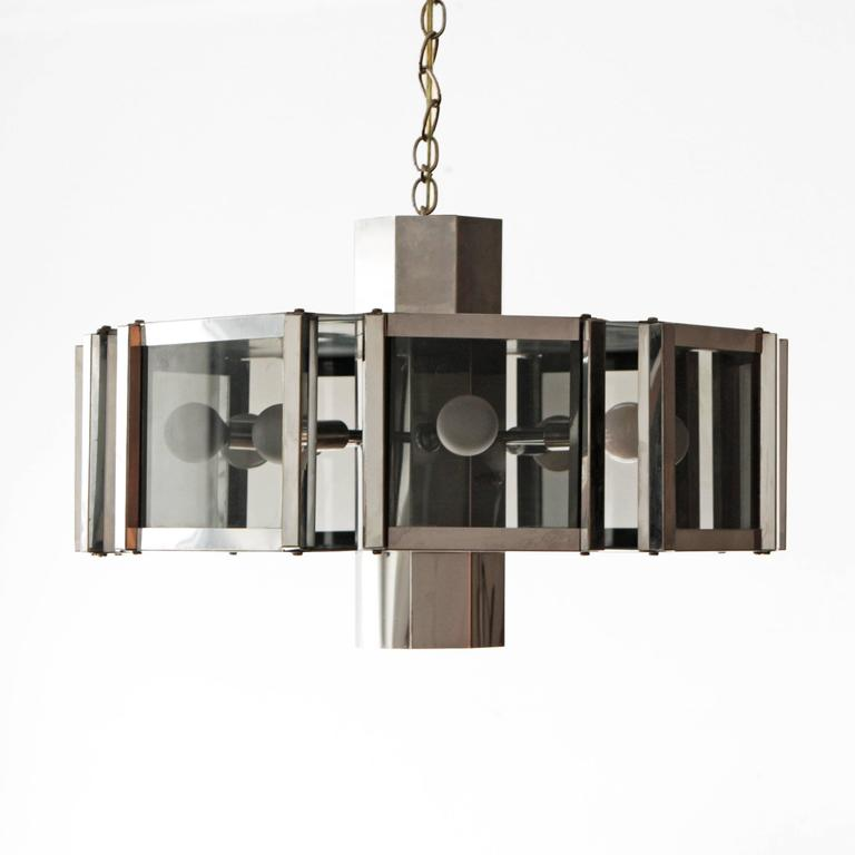 Chandelier designed by Robert Sonneman. Chrome with smoked glass panels takes nine lightbulbs and looks great on a dimmer.