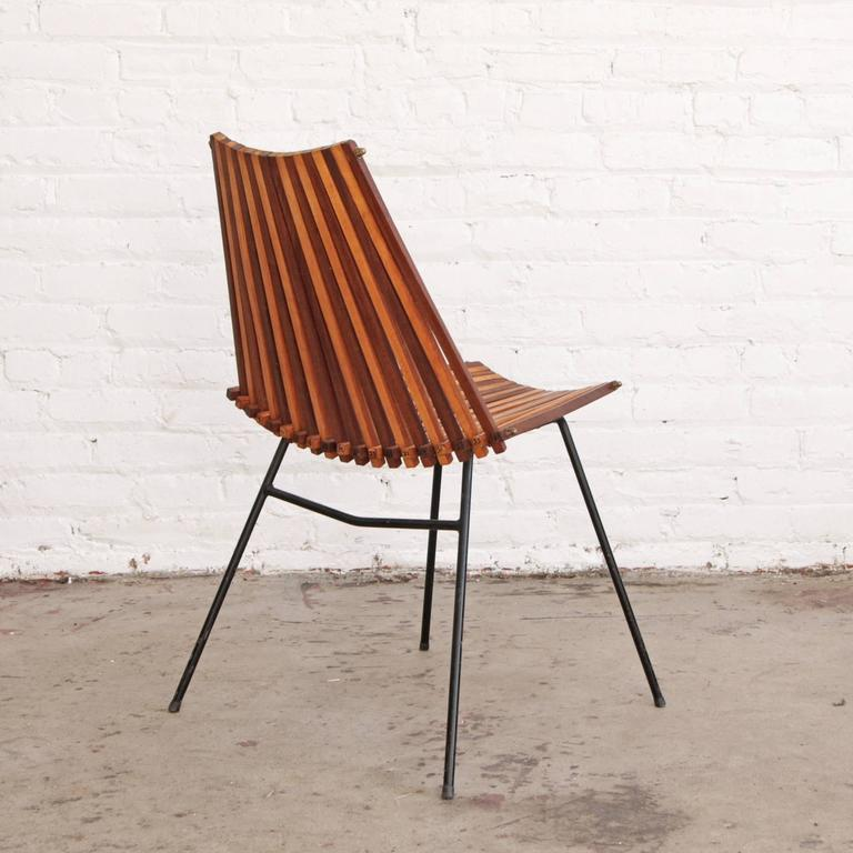 Lounge chair / side chair / desk chair by Dirk Van Sliedrecht for Rohé Noordwolde, Holland. Intersecting teak and birch two toned slats on wrought iron frame.