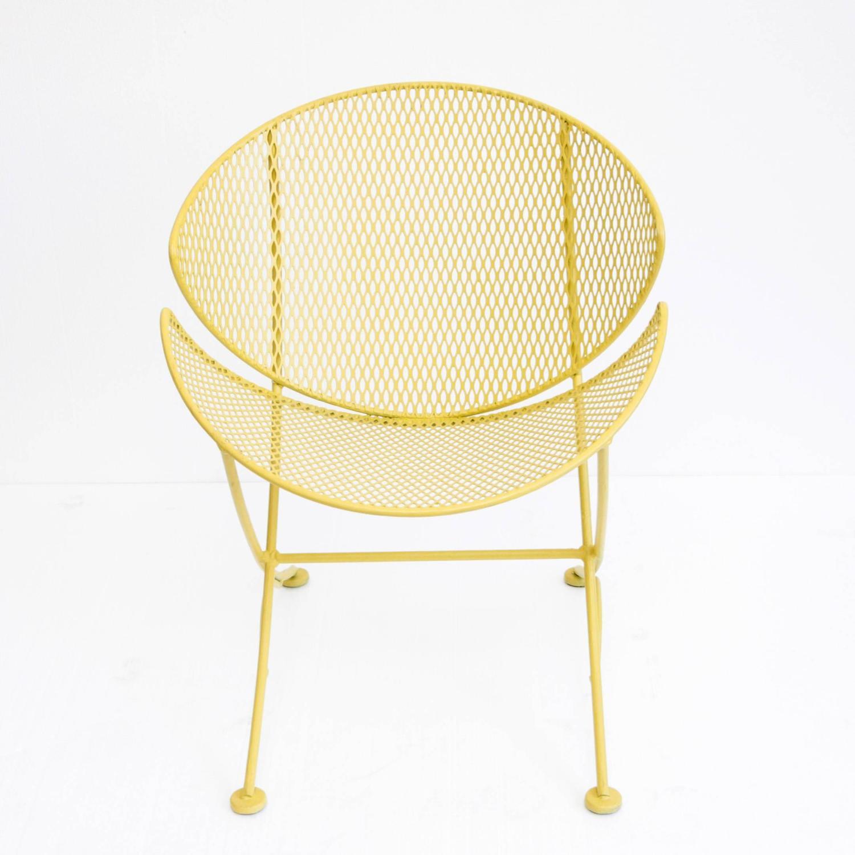 pair of maurizio tempestini orange slice patio chairs at