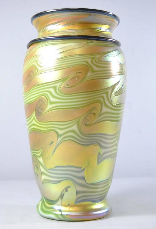 "Lundberg Studios King Tut art glass vase. Double design King Tut combed pattern applied coils. Good interior with great color. Signed on the bottom Lundberg Studios and LS 1-1-96. Measures: 10 3/4"" Tall"