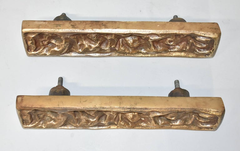 Heavy bronze brutalist deep relief pair door pulls attributed to architect Sherrill Broudy and sculpture Joy Verner. Stamped on the back H9.