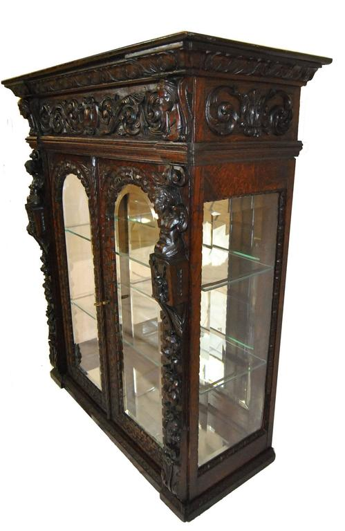 A Unique Gothic Revival Oak Counter Display Cabinet Is Heavily Carved In Fl