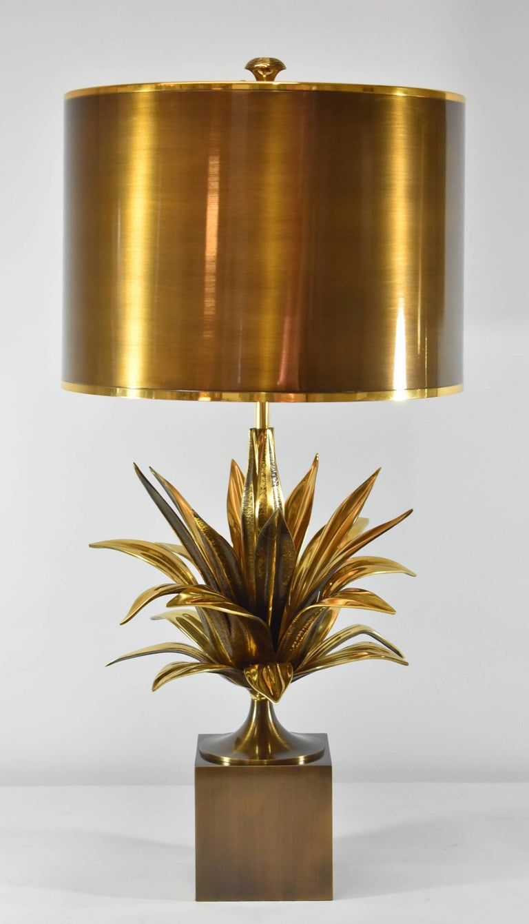 A cast bronze and gold metal table lamp with a plant theme by Charles Paris. These are