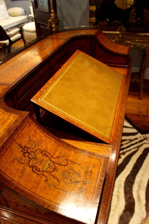 This remarkable 19th century George III satinwood and marquetry