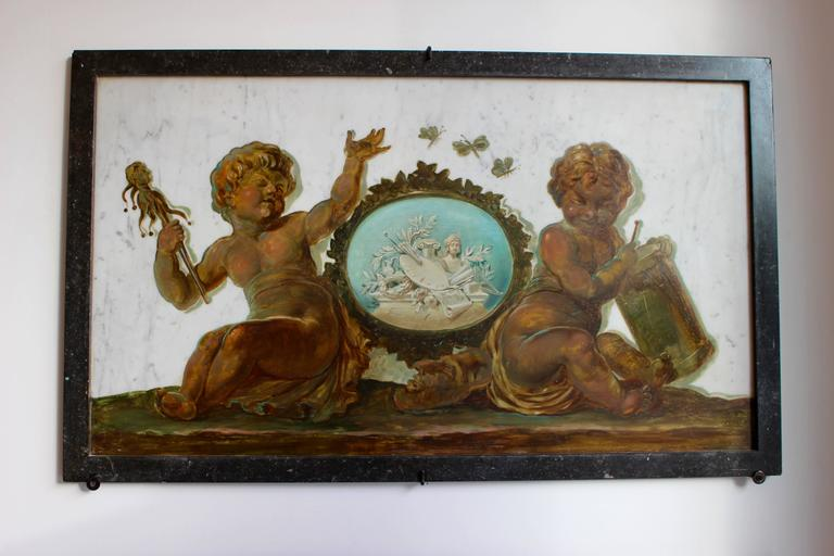 An early 19th century set of four trompe-l'œil oil overdoor paintings on marble representing allegories of the Arts by Flemish artist Piat-Joseph Sauvage (1744-1818). Painted on marble, each composition depicts two putti, painted to imitate a bronze