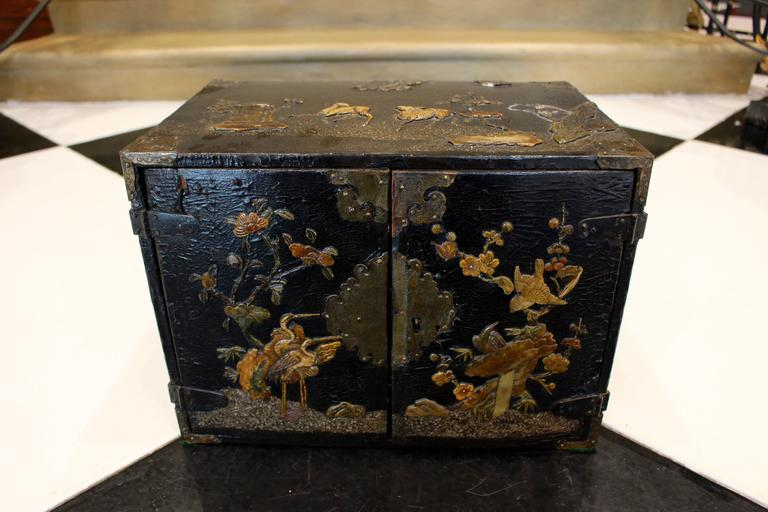 Brass Small Chinese Black Lacquered Wood Cabinet with Raised Traditional Scenery For Sale