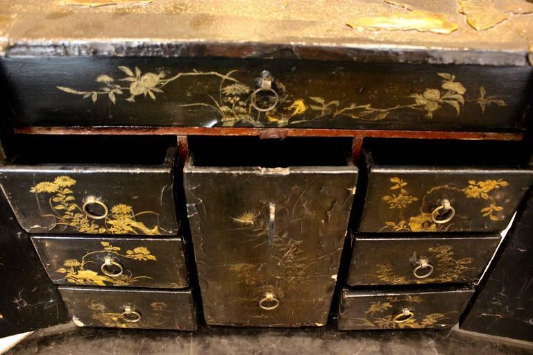 Gilt Small Chinese Black Lacquered Wood Cabinet with Raised Traditional Scenery For Sale