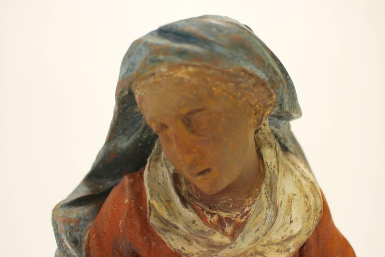 Polychromed 18th Century Continental Polychrome Terracotta Sculpture of the Kneeling Virgin For Sale