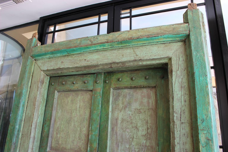 A wonderful Indian Neoclassical pale green painted doors and door surround. Rajasthan Early 19th century.