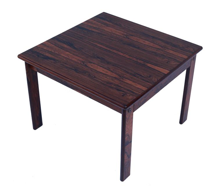 This stunning palisander table crafted in Finland can be used as a side table or possibly a coffee table.
