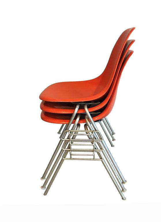 Stackable, Orange Herman Miller Chairs Designed By Charles And Ray Eames. A  Timeless Classic