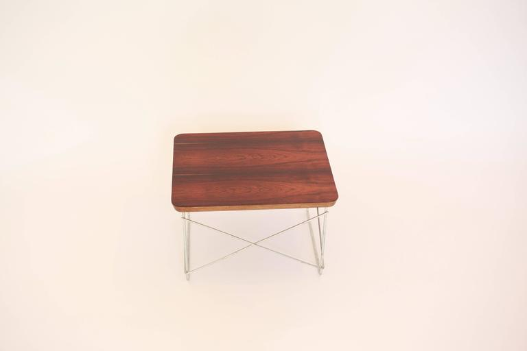 Rare Herman Miller rosewood veneer LTR. In 1996, Herman Miller released a limited edition of rosewood Eames LCW's and folding screens in an attempt use some of its stock of endangered rosewood before it reached its shelf life. A limited number of
