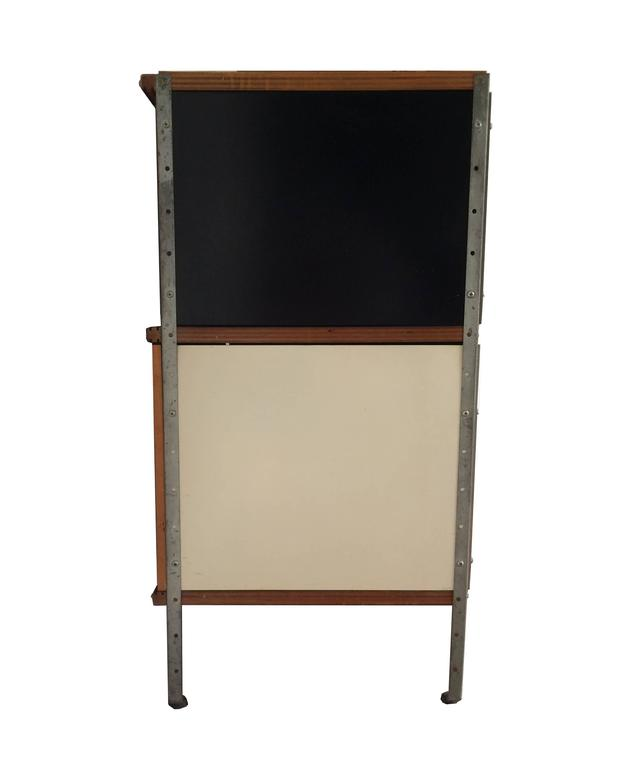 """A first year Eames Storage Unit (ESU) circa 1950-1951, manufactured by Herman Miller and designed by Charles and Ray Eames. The unit has four original """"dimple doors"""" that showcase the Eames hallmark pressed plywood techniques. This piece is from"""