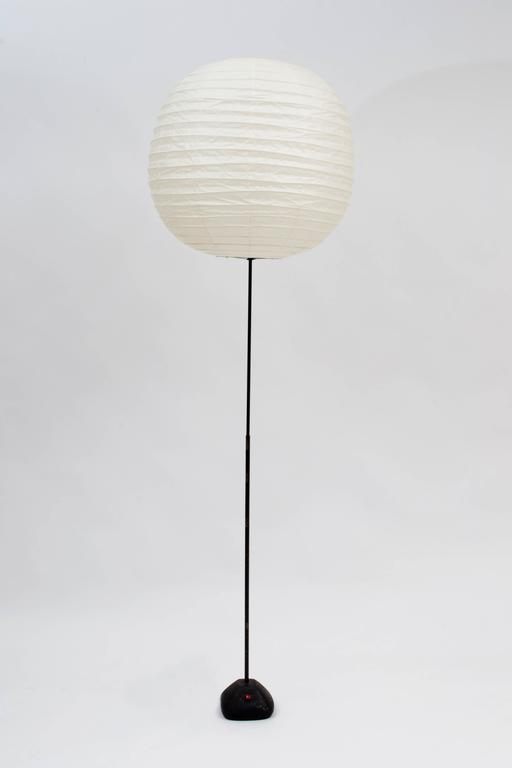 """This remarkable, vintage Isamu Noguchi Lamp from the estate of the late, renowned artist and sculptor, Erwin Kalla is signed """"Isamu Noguchi"""" in the bottom of the cast iron base. Authentic signed Akari Isamu Noguchi replacement shade is"""