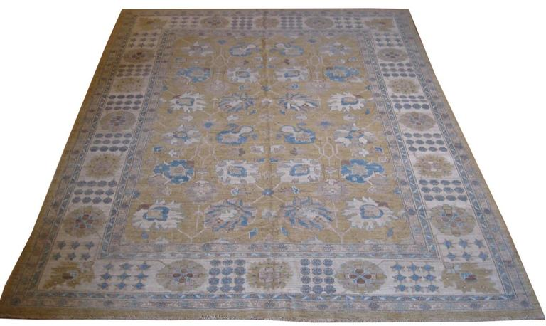 With its centuries old tradition of blending Western and Eastern influences, the Khotan rug style has a reputation for beauty and versatility in bridging design approaches.  This delightful Pakistani Khotan rug, was hand-knotted in Pakistan by