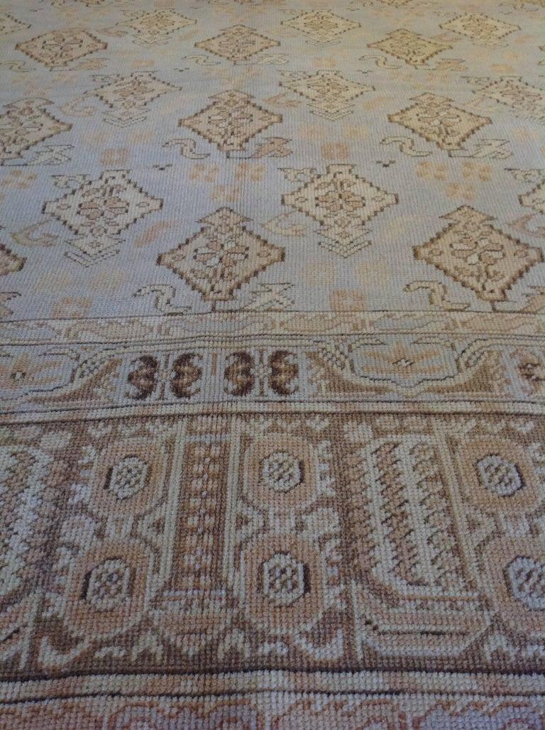 Transitional Euro design rug colors: Tan, cream, brown, grey, slate, blush.