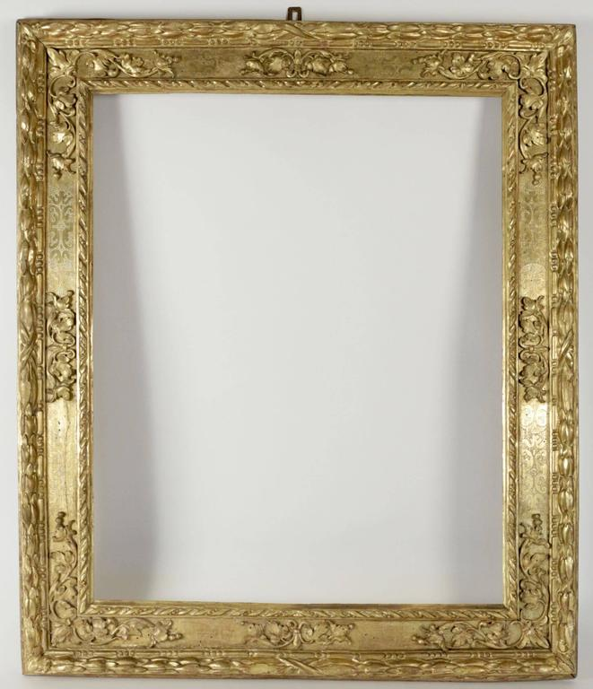 Beautiful Italian carved giltwood frame mounted as mirror, Northern Italy, 17th century.  Sight size as frame is: 88 cm x 71cm Overall size is: 114 cm x 97 cm. Mirror plate is modern