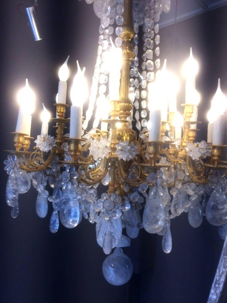 Fabulous rock crystal and chiseled gilt bronze chandelier, Lousi XVI style, 2016 early 20th century structure in gilt bronze with custom carved rock crystal drops and pearls. 24 lights Absolutely spectacular One of a kind.