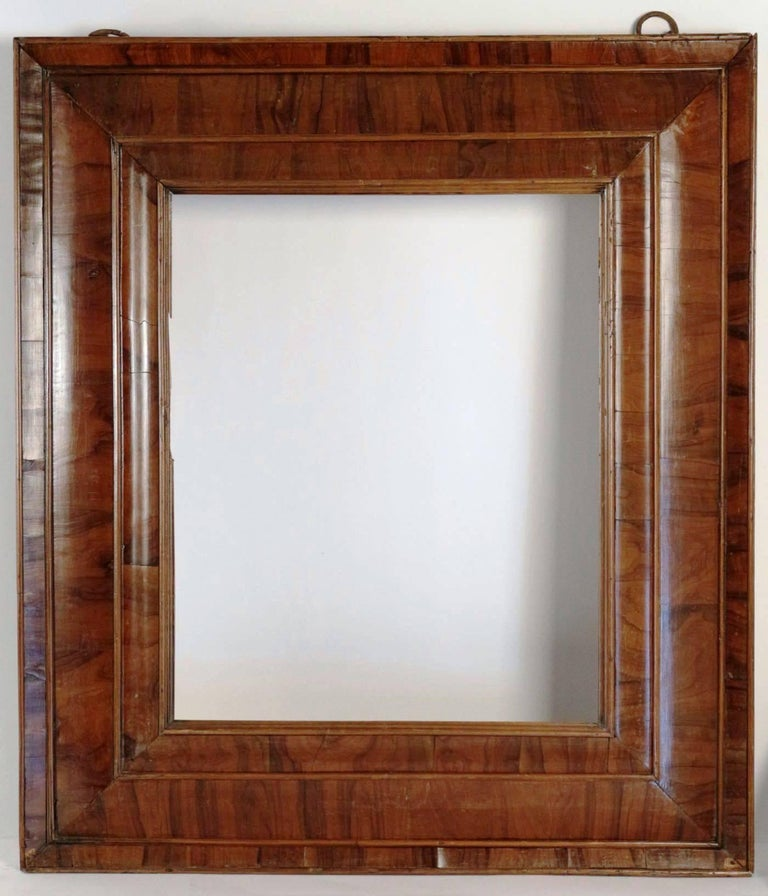 Extraordinary 17th century frame mounted as mirror, nutwood veneer, spectacular with original hooks,  Mirror plate later than frame Fabulous condition As a frame, sight size is 56 cm x 45.5 cm  Later mirror plate.