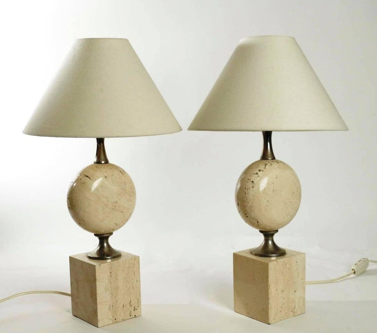 Rare and elegant pair of lamps by Philippe Barbier, travertine and metal, France, late 1960s