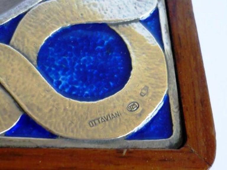 Fantastic smoking set, by Ottaviani, silver, enamel and wood, Italy, late 1970s. Ashtray Dimensions: 17 x 17 x 4 cm Cigarette Box Dimensions: 17 x 11 x 4 cm Match box with scraper Dimensions: 10 x 10 x 4 cm  Minor cracks on the corner of