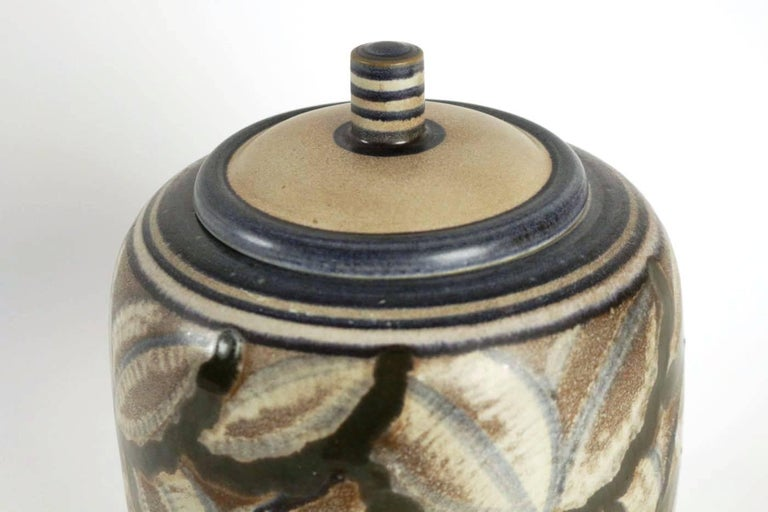 Manufacture de Sèvres Large pot with top sandstone with decors of stylized flowers, Art Deco period, shape created by Gensoli, design by André Naudy, stamp of Sèvres under the base and dated 1933. Measures: height 32 cm diameter 23 cm.