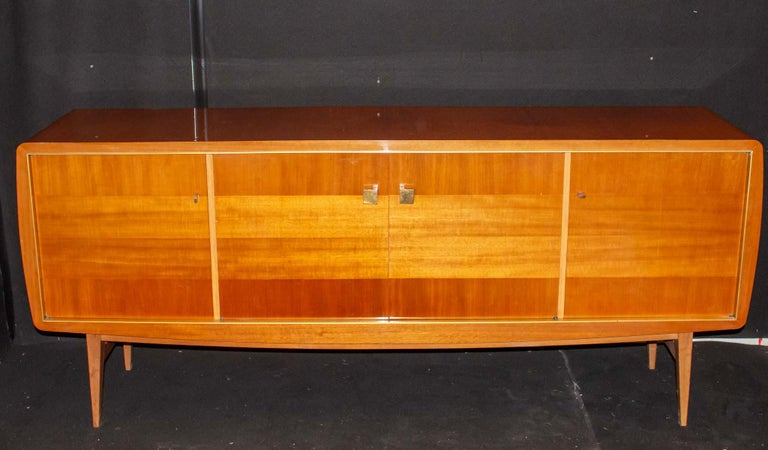 Fabulous large sideboard by Roger Landault, France, 1950s, probably Ashtree  Born in 1919, Roger Landault studied at the Lycée des Arts Appliques in Paris. His career is marked by his ability to adapt: ??the English designer has evolved from a