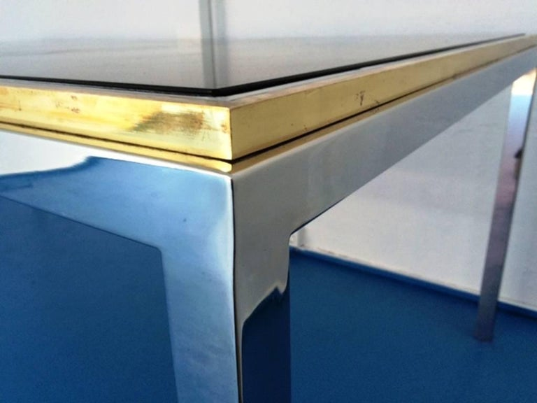 Beautiful Flaminia dining room table or desk by Willy Rizzo, chrome, gilded brass, France, 1970s, with transparent glass top.