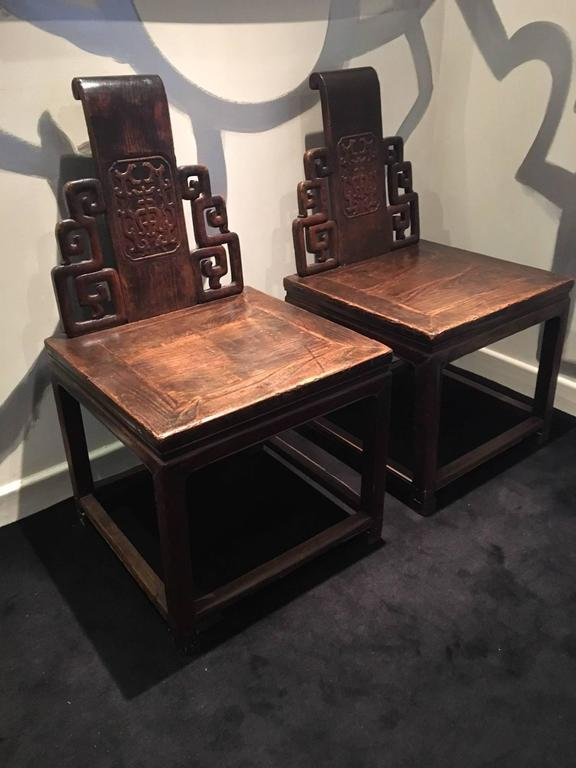 A very decorative pair of Chinese chairs, with a square seating and a central back, probably composed with different pieces of furniture from 19th century, and from a private and special order.