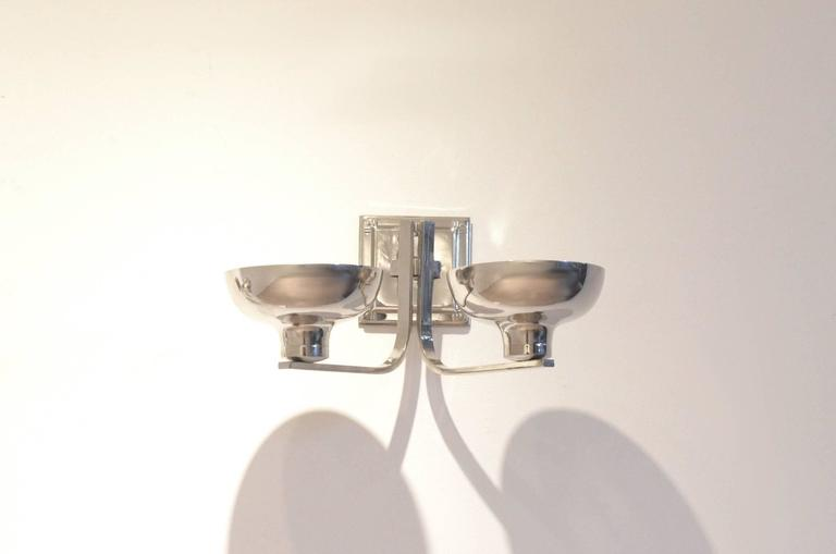 Set of two wall sconces originating from Belgium. Manufactured in the 1940s. Classic shaped nickeled metal structure.