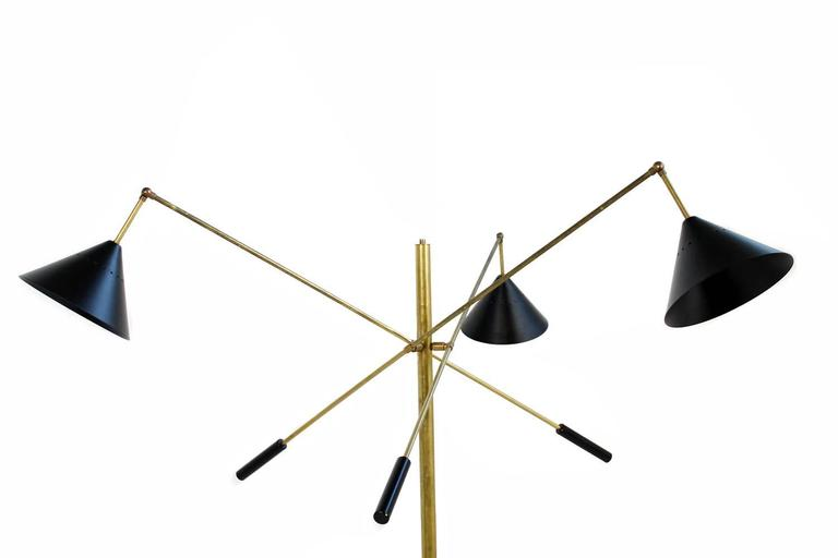 Beautiful adjustable Italian Floor Lamp, very unique with a black marble base, brass and lacquered metal shades. Each one for an E27 bulb. The lamp is already rewired and can be used in Europe and also in the US. Adjustable arms and end parts.