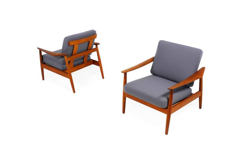 Beautiful pair of Arne Vodder easy chairs, renewed upholstery and covered with new woven fabric. Very good condition, a matching sofa is available.