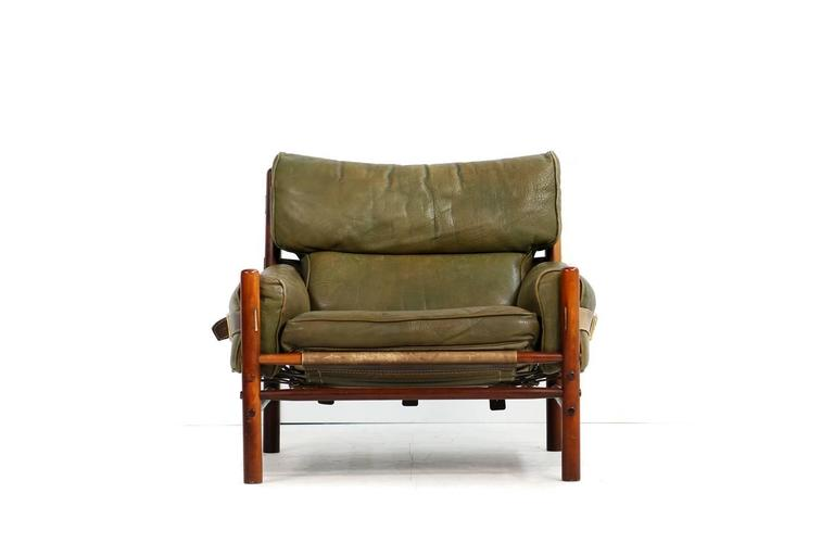 Beautiful vintage and authentic Arne Norell leather lounge chair, made by Aneby Mobler in Sweden. Mod. Kontiki, in an amazing condition, leather belts and brass parts, stained beechwood, also the base in a very good condition.