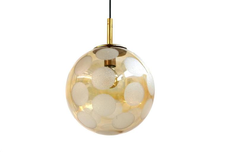 Nice pendant globe lamp from the 1970s with fantastic frosted glass dots and brass parts. For one E27 bulb up to 60W. Nice patina on the brass parts. It can be used in Europe and also in the US or Asia.