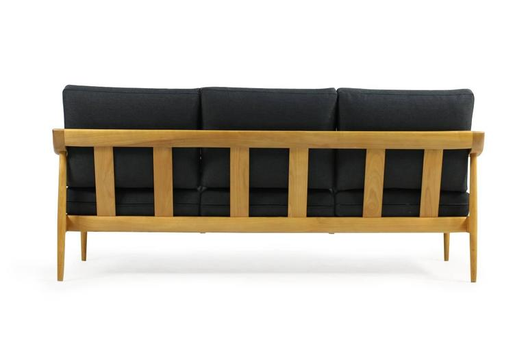 Fantastic 1950s Wilhelm Knoll cherrywood sofa, Knoll Antimott series. Very good condition, new upholstery and newly covered with anthracite woven fabric. Freestanding.