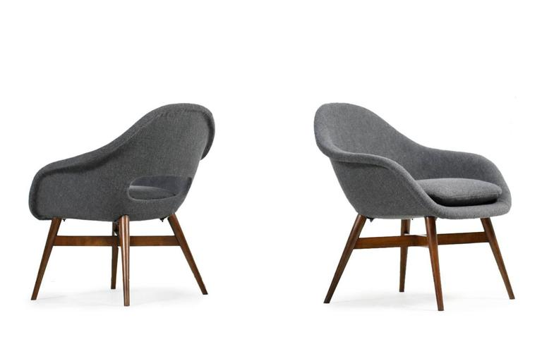 Rare and beautiful pair 1960s Miroslav Navratil lounge chairs with fiberglass shells, new upholstery and covered with new wool/cotton fabric in grey with multicolored pigments, a beautiful and rare fabric. The wooden base made of stained beech or
