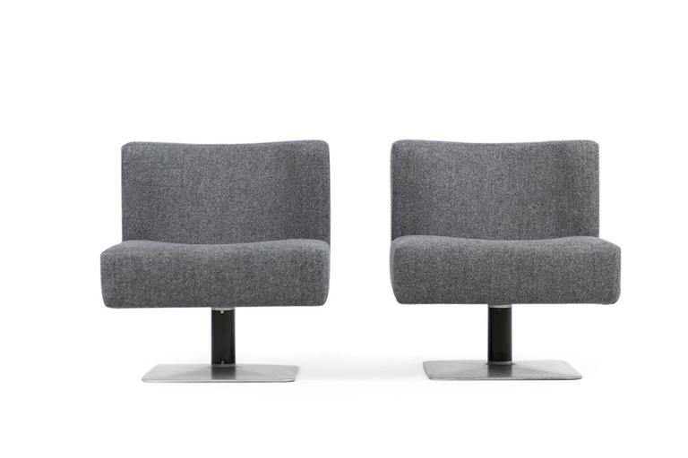 Beautiful pair of 1970s Herbert Hirche model 350 modular lounge chairs, made by Mauser Werke, circa 1974/1975 New upholstery and covered with grey wool woven fabric, metal and iron base, beautiful form and design. Each chair ca. W69cm x D 67cm x H