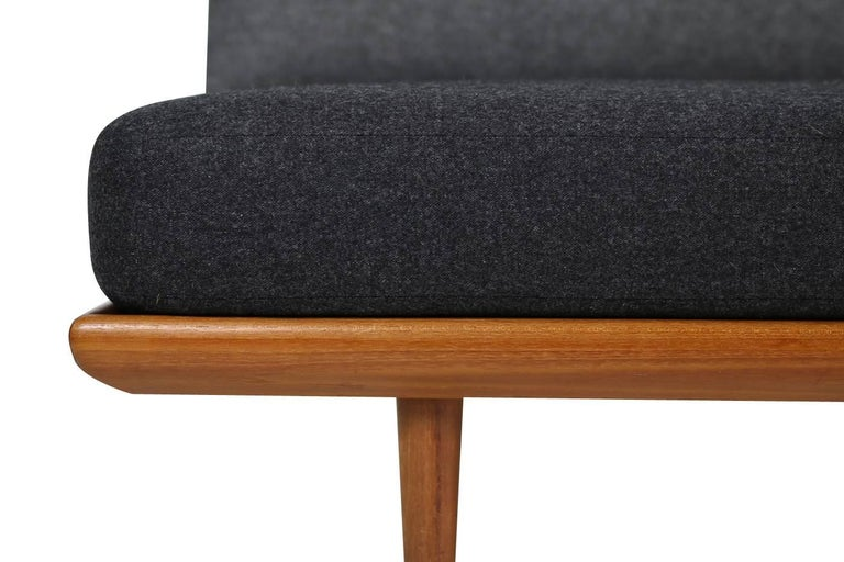 Beautiful 1960s Danish modern daybed, designed by Peter Hvidt & Orla Mølgaard Nielsen, produced by France & Son, marked. Renewed upholstery and covered with high quality wool fabric in two tone, grey and dark grey (almost black) a beautiful
