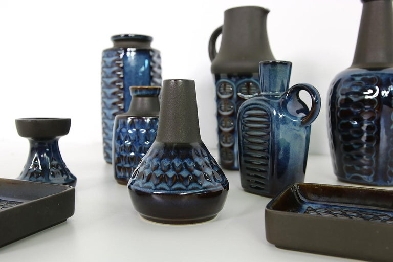 Beautiful set of nine (9) pieces, vases and bowls, collector's condition, beautiful, blue glaze mixed with matt black, beautiful pottery art. Six vases, one candle stick holder, two bowls.  The vases are 26, 25, 22, 16, 2x 13, 9cm high, the bowls