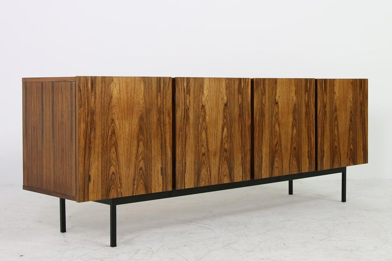 Beautiful 1960s Minimalist sideboard, shelves and drawers inside, great authentic condition, unknown designer, very high quality, probably made to order or an unique item. Beautiful wood outside and maple wood inside. Very rare model, super nice