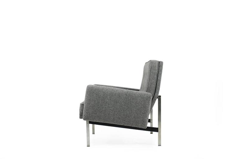 A beautiful Florence Knoll armchair from 1959 for Knoll International. New upholstery and high quality fabric wool fabric. Frames with slightly patina, beautiful condition, matching pair of lounge chairs and a sofa available.