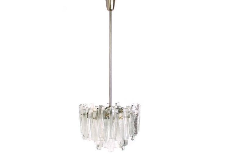 Beautiful Kalmar chandelier, massive iceglass parts, very good condition. Diameter of the lamp ca. 36cm and 25cm height, total height ca. 100cm, overall for seven bulbs E14 produced in Austria in the late 1970s