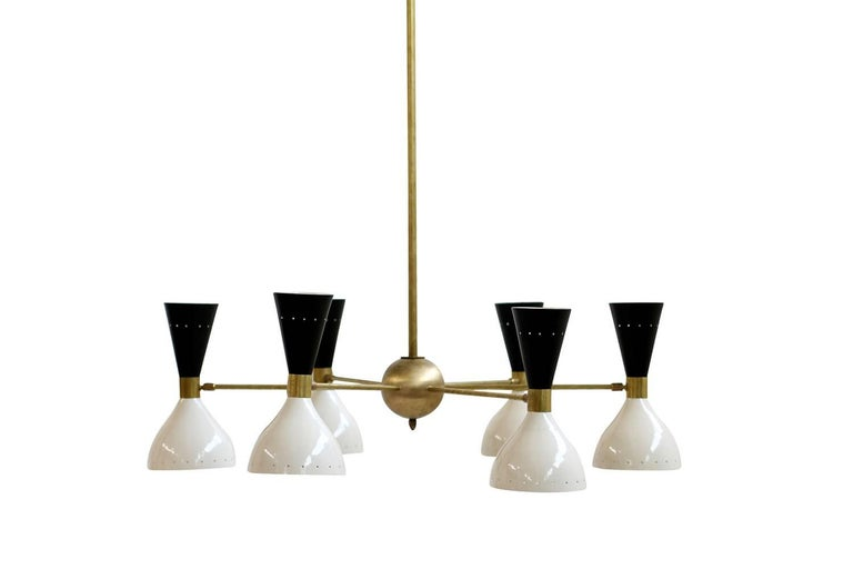 Beautiful Italian six-arm chandelier, the lampshades are adjustable and can light in different directions, every lampshade is for two bulbs, it can be used with both bulbs or only with one. Beautiful design and beautiful light. Fantastic condition