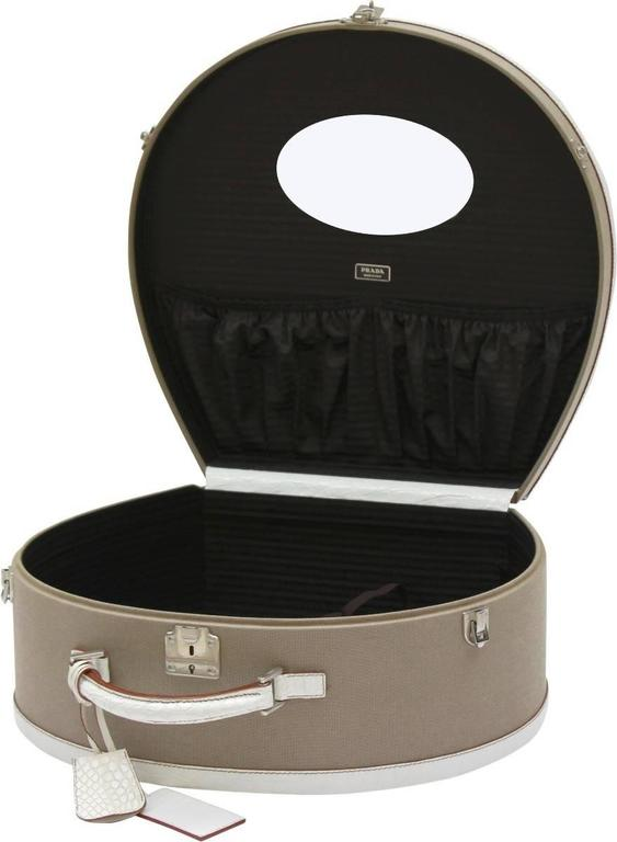 30721da5143 Stunning Prada canvas and crocodile edged hat box. This exquisite hatbox is  handcrafted in Milan