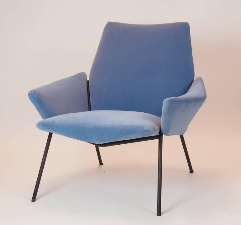 Rare diamond armchair designed by Giuseppe Rossi for Rossi di Albizzzate, recovered in Italian cotton blue velvet, with black lacquered structure. The diamond shape of all its sides is surely precursor of the design of that time. Original label is